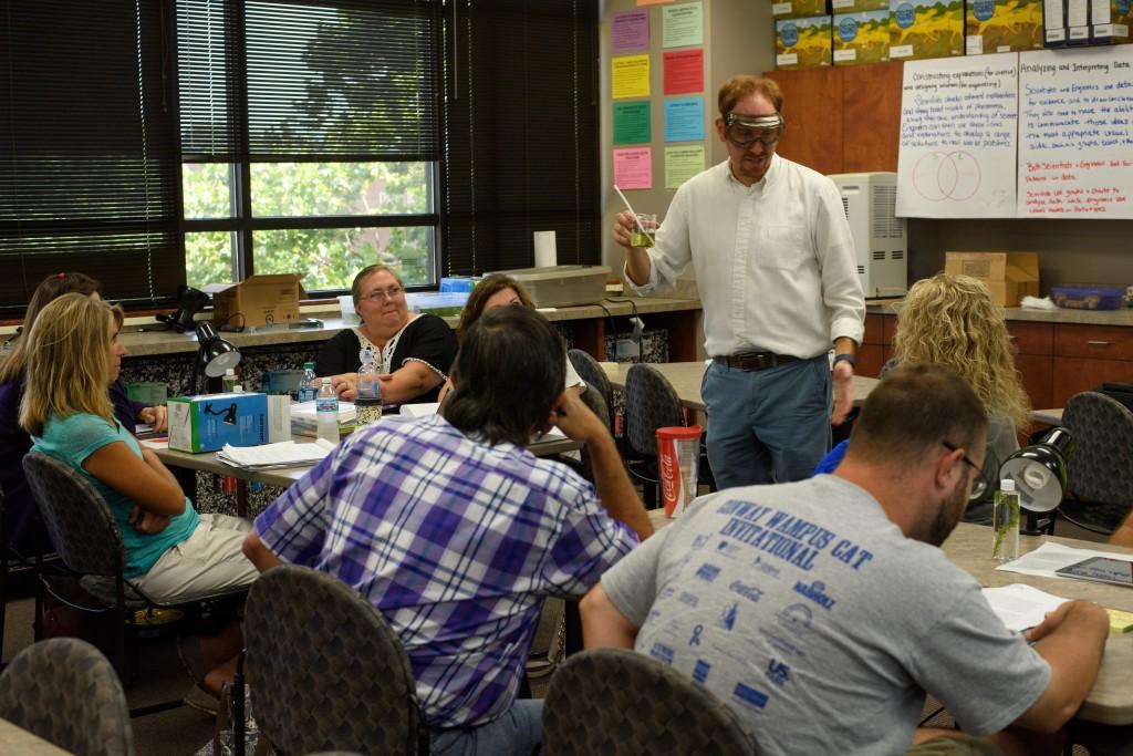 Photo of Dr. Jon White instructing teachers in the STEM Center's workshop.